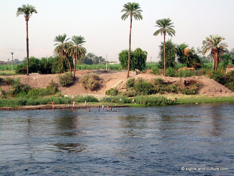 Nile scenery with bathing people